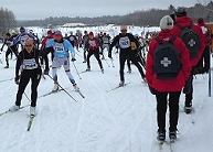 Nordic patrollers awaiting their times to begin patrolling a large x-c race.